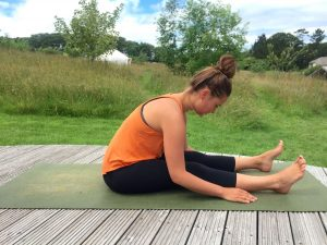 6 yin yoga poses to bring back your summer shine